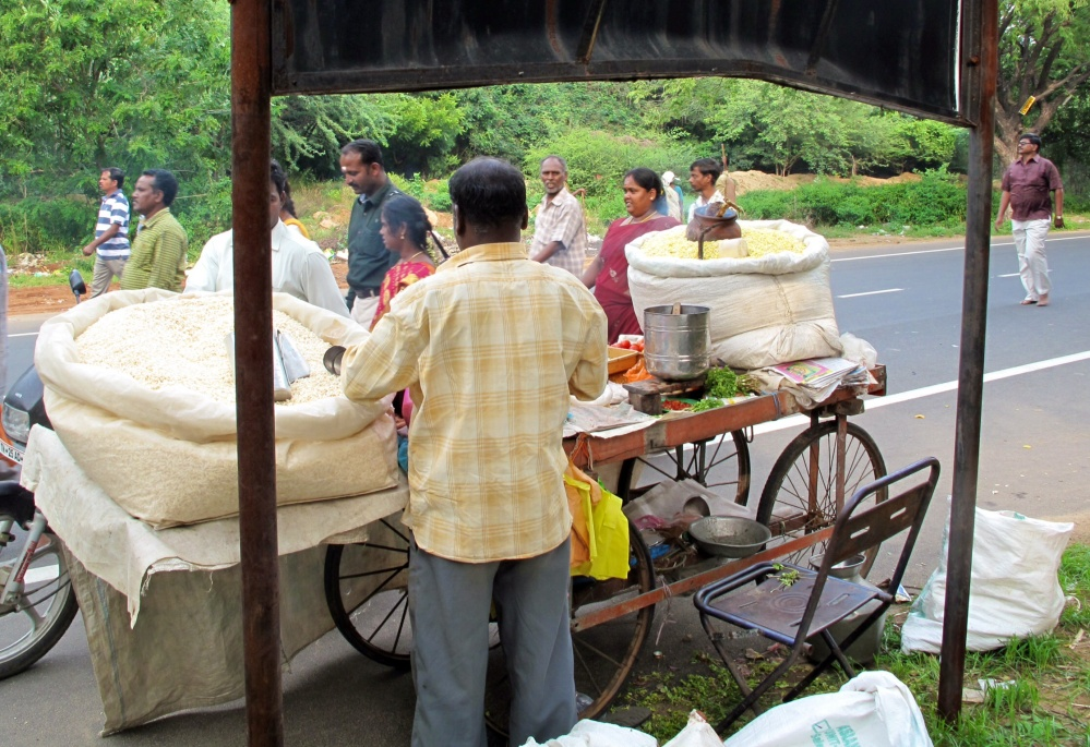 As you can see by the back-up stock of this small puffed rice and fried Dahl stall, expectations of sales are reliably high.
