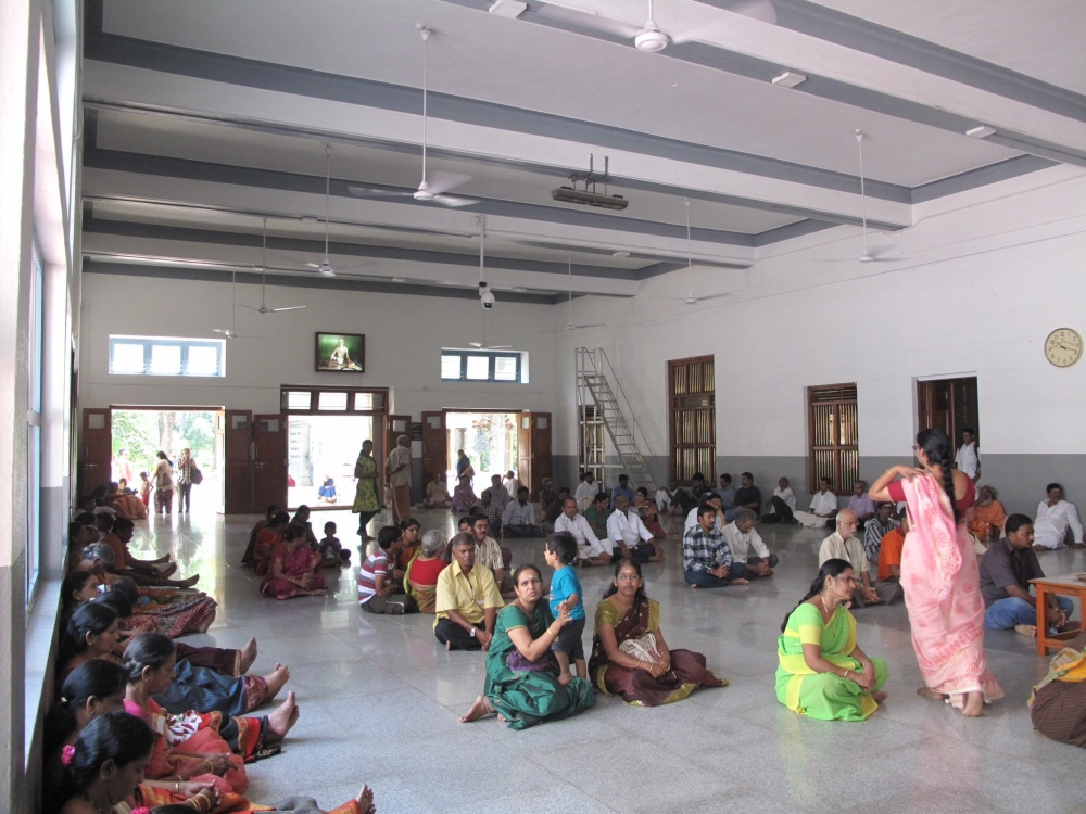 The Big Hall in ashram  offers a calm relaxed space for the internal dialogue to acquiesce to the pervading comfortable quiet.