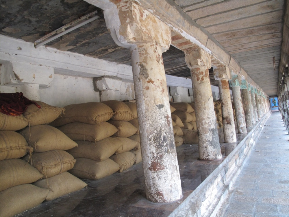 Bags of rice line the long arcade ready for the big cook-up