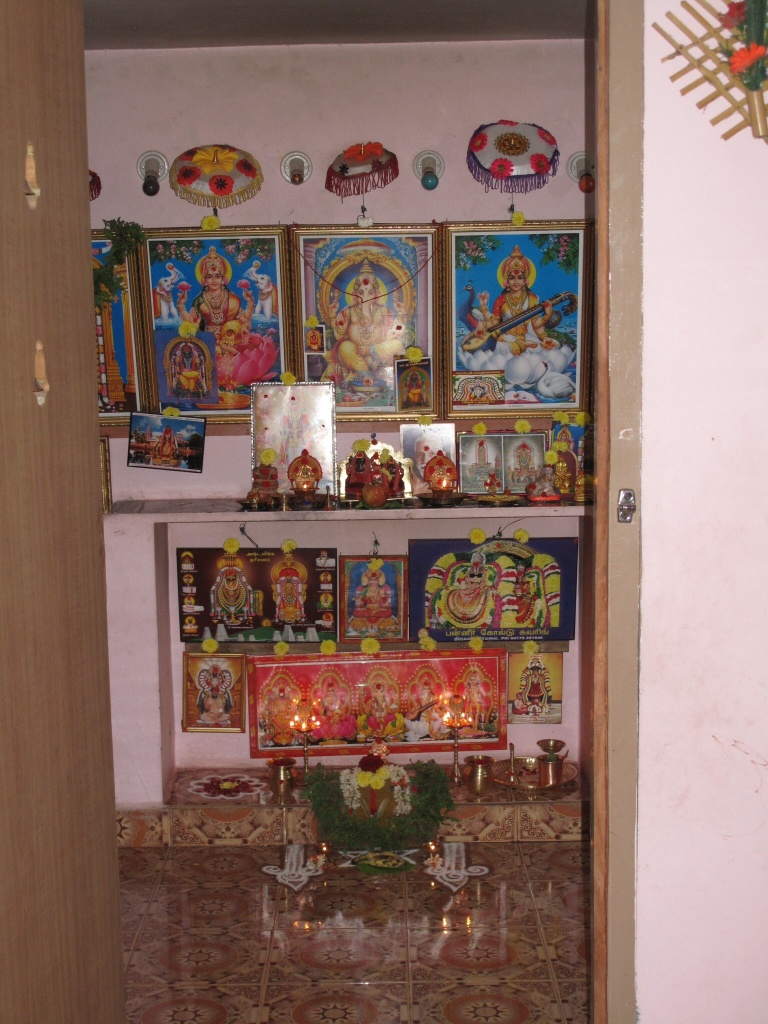 Is today a Special Day? I asked Mohana - seeing the oil lamps, designs, flowers and stuff in her doorway and then this magnificent welcome in her shrine room.  Yes, she said, it's Friday.